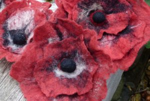 Close up image of felted poppies